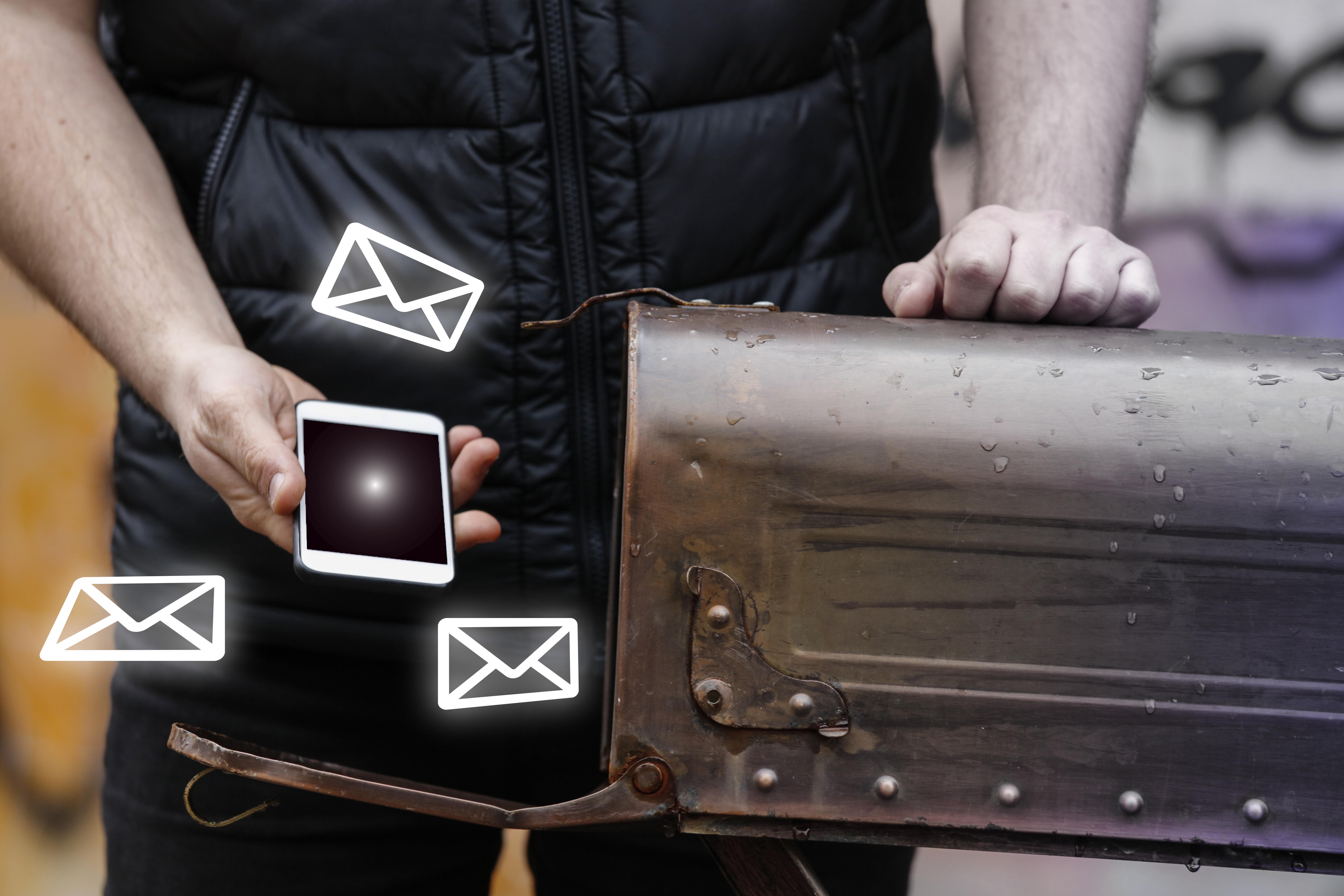 Man at Mailbox with phone
